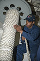 U.S. Navy Seaman Apprentice Trevor Ellam secures mooring line on a reel aboard the guided missile destroyer USS Stout (DDG 55) while departing Aksaz Naval Base Nov. 12, 2013, in Aksaz, Turkey 131112-N-UD469-156.jpg