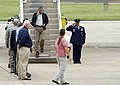 U.S. President Barack Obama, center, salutes as he steps off of Air Force One at Tinker Air Force Base, Okla., May 26, 2013, enroute to surrounding areas damaged by recent tornadoes 130526-F-IE715-145.jpg