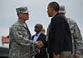 U.S. President Barack Obama, right, greets Air Force Col. Steven Bleymaier, the commander of the 72nd Air Base Wing, at Tinker Air Force Base, Okla., May 26, 2013, en route to surrounding areas damaged by recent 130526-F-RH756-158.jpg