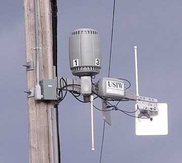 Neighborhood wireless WAN router on telephone pole USI router.jpg