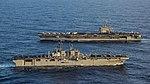 USS America (LHA-6) passes USS Carl Vinson (CVN-70) in the Pacific Ocean on 20 January 2018 (180120-N-BL637-0045).JPG