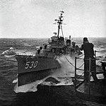 USS Trathen (DD-530) is refueled in heavy seas, circa in 1957.jpg