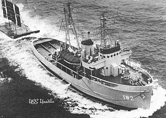 USS Unadilla (ATA-182) - USS Unadilla (ATA-182) underway while towing a target sled, date and location unknown