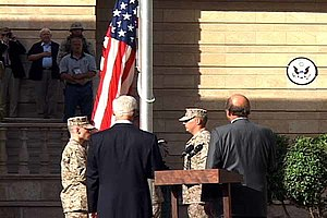 Embassy of the United States, Baghdad - Former Ambassador to Iraq John D. Negroponte, right, shows honors to the colors as U.S. Marine Security Guards raise the U.S. flag on the grounds of the old U.S. Embassy in Iraq on July 1, 2004.