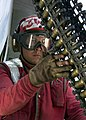 US Navy 021004-N-8497H-001 An Aviation Ordnananceman performs final checks on each 20mm round of ammunition before it is loaded onto an aircraft.jpg