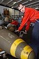 US Navy 030321-N-4953E-007 An Aviation Ordnanceman moves a 2,000 lb. Joint Directional Attack Munition (JDAM) from the weapon's magazine to the hangar bay of USS Harry S. Truman (CVN 75).jpg