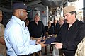 US Navy 030328-N-2420K-001 Hull Technician 1st Class Aaron Marshall, Sailor Of the Year presents a command ball cap to Master Chief Petty Officer of the Navy (MCPON) Terry Scott during his visit to Sasebo.jpg
