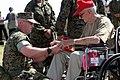 US Navy 040312-M-0000Y-001 World War II veteran William Leverence autographs a book for U.S. Marine Staff Sgt. Cox on the island of Iwo Jima just before the Iwo Jima ceremony kicks off.jpg