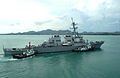 US Navy 040708-N-4104L-031 The guided missile destroyer USS Russell (DDG 59), is assisted by two tugboats as it returns to port following the Thailand phase of exercise Cooperation Afloat Readiness and Training (CARAT).jpg