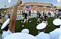 US Navy 040904-N-9693M-003 The U.S. Naval Academy Midshipman Football team runs onto the field to take on the Duke Blue Devils.jpg