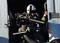 US Navy 041031-N-5345W-058 A door gunner aboard an SH-60 Seahawk prepares for landing aboard USS Harry S. Truman (CVN 75).jpg