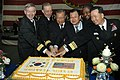 US Navy 050314-N-4053P-081 Commander, Carrier Strike Group Five (CSG-5), Rear Adm. Jamie Kelly, left, along with distinguished visitors, cut a cake at a reception for Korean dignitaries and guests held aboard USS Kitty Hawk (CV.jpg