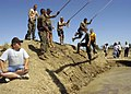 US Navy 050611-N-6060O-157 Participants prepare to swing across an obstacle during the 12th Annual Marion Carl Memorial Mud Run on board Naval Air Station Lemoore, Calif.jpg
