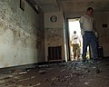 US Navy 051020-N-3729H-030 U.S. Navy Airman Eric Labrecque, assigned to the Nimitz-class aircraft carrier USS John C. Stennis (CVN 74), enters a church in Slidelle, La., during cleanup efforts.jpg