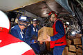 US Navy 060219-N-4772B-030 Aboard the dock landing ship USS Harpers Ferry (LSD 49) Sailors and Marines load relief supplies aboard a CH-46E Sea Knight.jpg