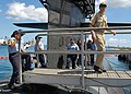 US Navy 060520-N-3228J-047 Ensign Ted Doukas assigned to the Los Angeles class attack submarine USS Houston (SSN 713) leads Sea Cadets back across the brow as he and his group finish a tour of the boat.jpg