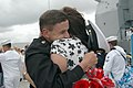 US Navy 070420-N-4047W-052 Chief Gunner's Mate Brian Binder hugs his wife Kristine upon his return from deployment aboard guided missile cruiser USS Lake Champlain (CG 57).jpg