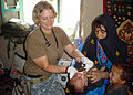 US Navy 070815-N-0000X-001 Hospital Corpsman 1st Class Jennifer Kraus de-worms an infant Afghan boy.jpg