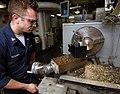 US Navy 070822-N-8923M-142 Machinery Repairman 2nd Class Patrick Koenig machines metal on a lathe in the machine shop of Nimitz-class aircraft carrier USS Harry S. Truman (CVN 75).jpg