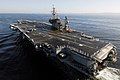 US Navy 070921-N-6106R-036 Sailors man the rails of USS Kitty Hawk (CV 63) as the ship transits into Truman Bay following a four-month summer deployment.jpg