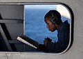 US Navy 071020-N-7981E-106 Yeoman Seaman Ernest Matthews studies advanced qualifications while standing by to relay messages using a sound-powered phone as the Nimitz-class aircraft carrier USS Abraham Lincoln (CVN 72).jpg