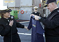 US Navy 090109-N-3316L-221 Capt. Cindy Thebaud presents an APS T-shirt to Chief of Naval Operations (CNO) Adm. Gary Roughead.jpg