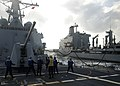 US Navy 091111-N-9520G-060 Sailors aboard USS Mustin (DDG 89) man the phone and distance line during an underway replenishment.jpg