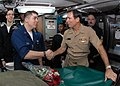 US Navy 091125-N-7705S-093 Vice Adm. Jay Donnelly, commander, Submarine Force, congratulates Electronics Technician 2nd Class Robert Flores for exceptional performance.jpg