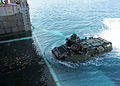 US Navy 100202-N-6676S-004 Marines, assigned to the Marine Air-Ground Task Force for Africa Partnership Station West guide an amphibious assault vehicle into the well deck of the amphibious dock-landing ship USS Gunston Hall (L.jpg