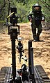 US Navy 100719-O-5986R-052 An Australian sailor assigned to Australian Clearance Diving Team 1 operates a Talon bomb disposal robot at an explosive ordnance disposal training site during Rim of the Pacific (RIMPAC) 2010.jpg