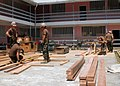 US Navy 100902-N-4971L-016 Seabees assigned to Naval Mobile Construction Battalion (NMCB) 7 embarked aboard High Speed Vessel Swift (HSV 2), build an additional classroom structure at Plaisance Community High School.jpg