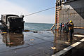 US Navy 110316-N-2348B-012 A Sailor aboard the amphibious dock landing ship USS Tortuga (LSD 46) guides a Japan Ground Self-Defense Force truck car.jpg