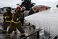 US Navy 110701-N-NR955-188 A firefighting team puts out a fire during a disaster training exercise at the Portuguese School of Naval Technologies t.jpg