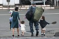 US Navy 110822-N-SF508-051 IT1 Christopher Binning walks off the pier with his family, heading home after a summer patrol.jpg