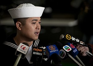 US Navy 111227-N-DR144-613 A Sailor speaks to members of the Hong Kong press.jpg