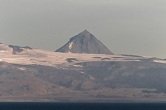 Unimak Island - Pogramni (6569ft, 2002m) volcano as seen from the Unimak Pass in morning light.