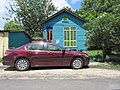 Upper 9th Ward New Orleans July 2017 Colorful House Red Car.jpg
