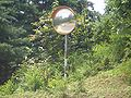 VM 5349 G209 north of Muyu - mirror at a hairpin bend.jpg