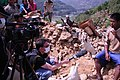 VOA Correspondent Steve Herman, with videographer Zinlat Aung, interview a man sitting atop the rubble of his home in Majigaon village, Sindhupolchok district, Nepal which crumbled in the April 2015 earthquake.jpg