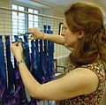 Vanessa Southern removing ribbons at Unitarian Church.jpg
