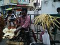 Vendor selling coconut shoot at Arasavilli Sri Suryanarayana Swamy temple.jpg