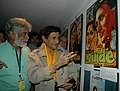 Veteran film star Dev Anand looking at the past while going round a photo exhibition at Kala Academy on the occasion of 37th International Film Festival of India (IFFI-2006) in Panaji, Goa on December 2, 2006.jpg