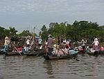 Vietnam 08 - 176 - tourists visiting a minority village (3186676457).jpg