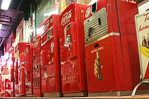 Cocacolonization - Vintage Coca-Cola vending machines from World War II. They resemble the machines spread out throughout the Pacific front.