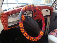 Cheerful Steering Wheel Cover On A Two Spoke Volkswagen Beetle