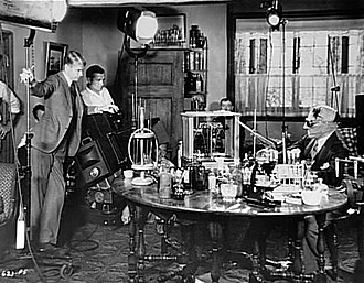 The Invisible Man (1933 film) - Director James Whale (left) and technicians on set of The Invisible Man starring Claude Raines (Universal, 1933)