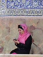 Young Woman with Cellphone - Outside Sheikh Lotfollah Mosque - Isfahan - Iran (7433220770).jpg