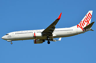 Virgin Australia Airlines (NZ) - In the new livery, a 737-800 on approach to Brisbane Airport in 2012