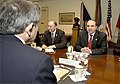 Zurab Zhvania and Gela Bezhuashvili meet with Paul Wolfowitz (April 28, 2004).jpg