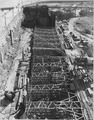 """""""The heavy timber struts between the sheet steel walls in section 'F.' Excavation to bedrock, 60 feet deep, is going... - NARA - 294000.tif"""